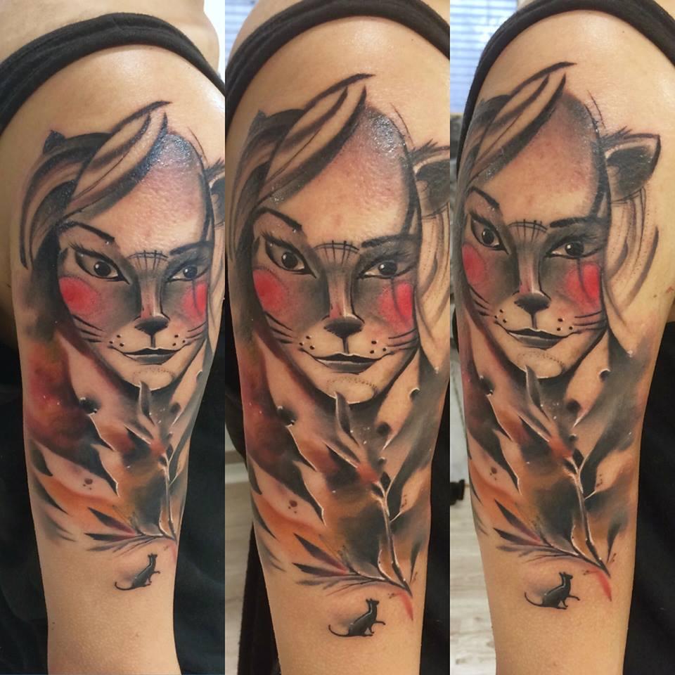 Lukasz Kaczmarek creative sleeve tattoo design