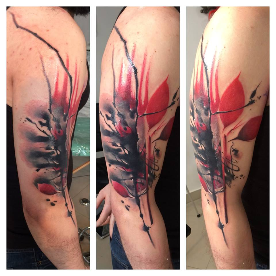 Lukasz Kaczmarek red and black half sleeve tattoo design