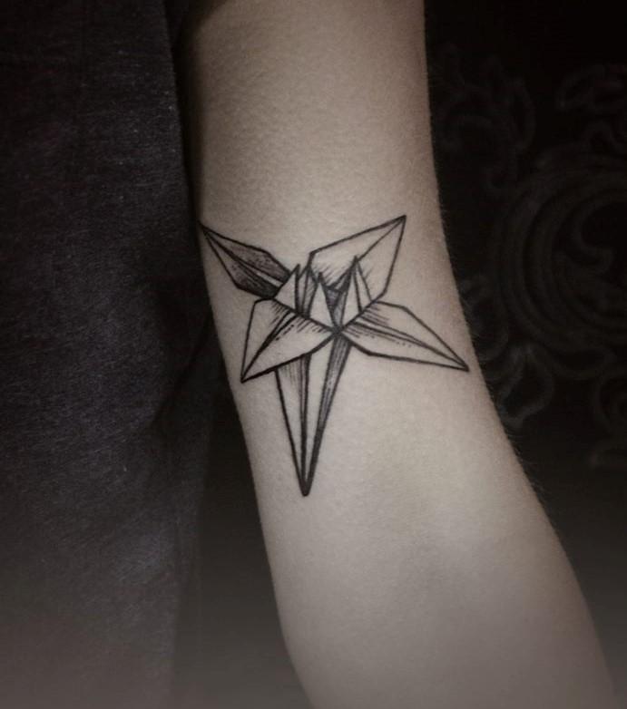 Diana Severinenko simple tattoo on arm