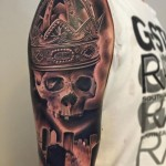 skull and cemetery tattoo designed on sleeve
