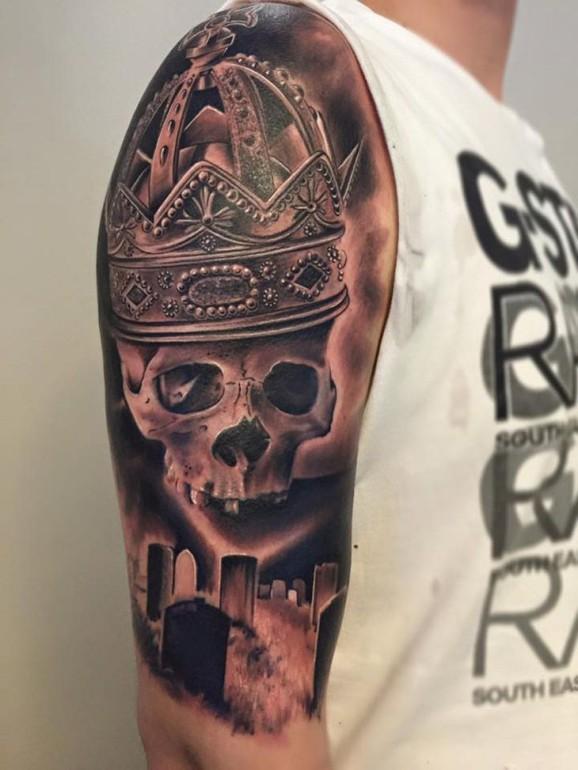 skull and cemetery tattoo designed on sleeve
